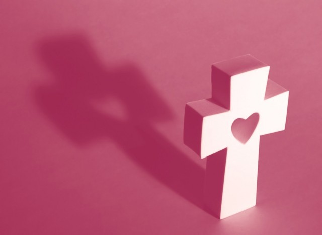 white-cross-with-heart-on-pink