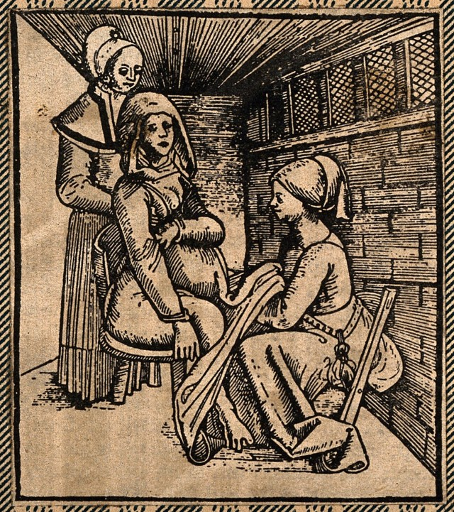 V0014914EL A woman seated on a obstetrical chair giving birth aided by